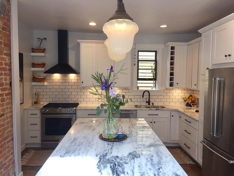 marble kitchen island with purple flowers in vase