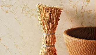 dreamy marfil quartz background with straw bundle and decorative bowl