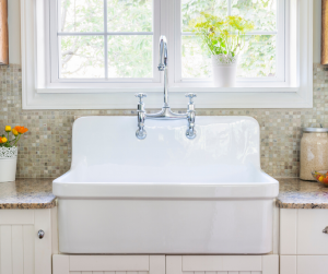 white cast iron sink with high back