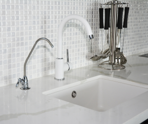 white drop in sink and white quartz countertops