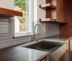stainless steel sink with grey quartz countertops