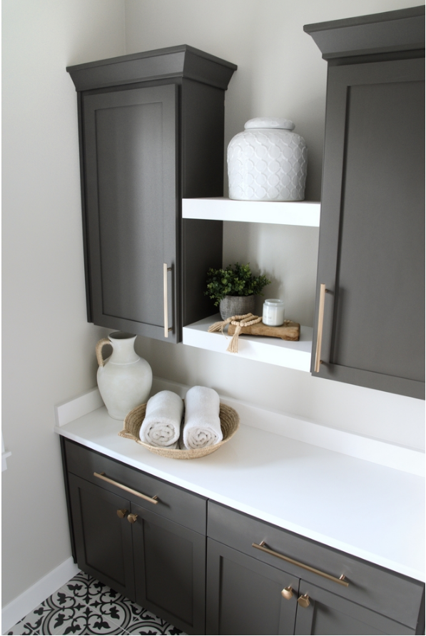 laundry nook with urbane bronze cabinets and white quartz countertop